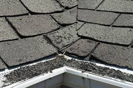 Old curling shingles on roof